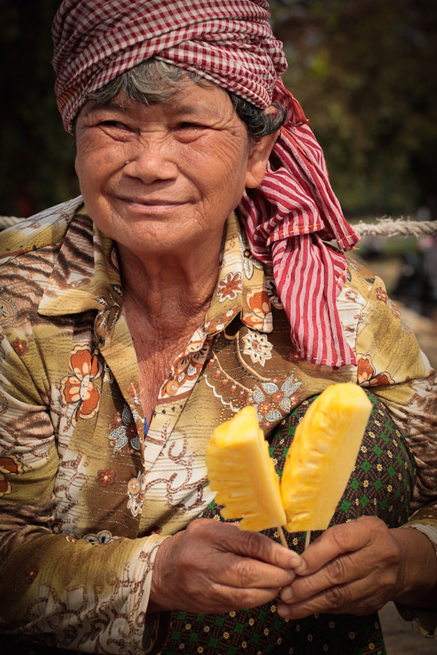 Cambodian woman with pineapple.
